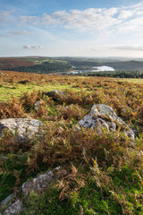 Stunning Autumn sunset landscape image of view from Leather Tor towards Burrator Reservoir in Dartmoor National Park