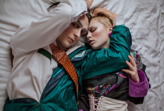 Fashionable couple lying on the bed