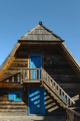Wooden house with blue doors