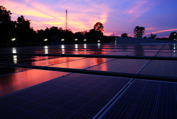 Solar PV Rooftop at Dawn Red Cloud Sky