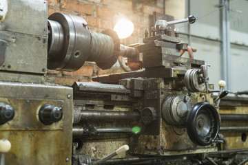 Old machinery in a factory from the mid-20th c. working machine-tool. old lathe.
