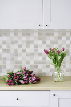 Lilac tulips in a clean contemporary kitchen