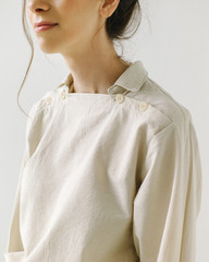 Young woman in white blouse