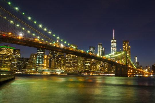 Brooklyn Bridge at night with water reflection, New York City Skyline, NY, USA