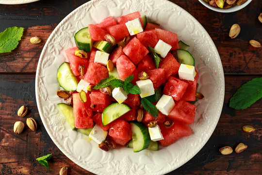 Healthy Watermelon, Cucumber Salad with Mint, pistachios nuts and feta cheese.