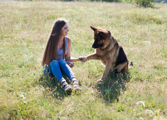 woman plays with the dog German Shepherd when training