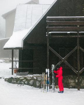 Woman placing ski in snow