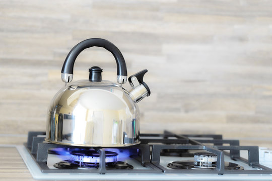 kettle on a gas stove flame burn not boiling
