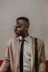 African American Businessman Portrait over a Grunge Wall