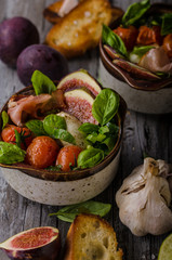 Homemade fresh figs salad with herbs and roasted garlic toast