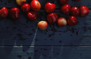 Fresh wet cherries on table