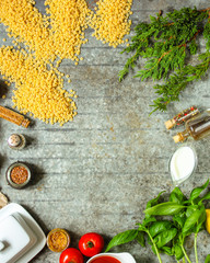 pasta stelline stars and a set of ingredients on the table. top view. food background