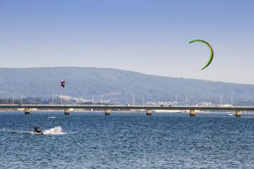 Kite surfing next to the bridge
