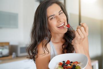 Brunette woman having healthy breakfast at home