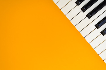 Abstract orange background with the piano keys in the up-right corner