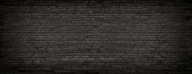 black brick wall, texture of dark brickwork close-up