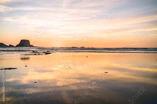 sunset on the rock beach  Romantic atmosphere sun waves and