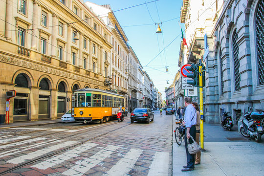 Tram and traffic on the old paved Streets of Milan