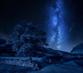 Fototapete - Milky way and falling stars over District Lake, England
