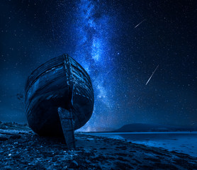 Fototapete - Milky way, falling stars and abandoned shipwreck, Fort William, Scotland