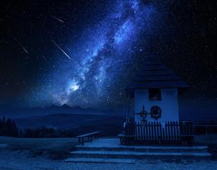 Milky way over small chapel in Tatra mountains, Poland