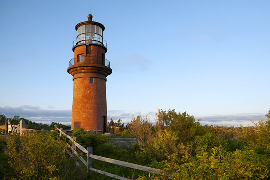 Wooden Fence Near Brick Tower of Aquinnah Lighthouse in Martha's Vineyard Island
