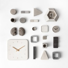 Flatlay of all concrete design items, organized neatly