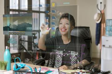 Smiling Professional Woman Operating a Futuristic Desktop Computer Screen