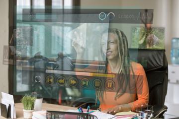 Professional Woman Operating a Futuristic Computer Video Screen