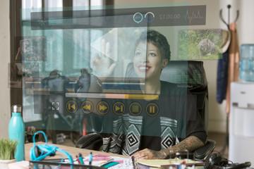 Smiling Professional Woman Operating a Futuristic Computer Video Screen