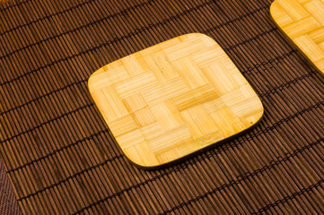 bamboo Mat - stand food with bamboo stands for hot, close-up, wooden background
