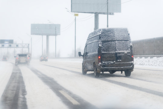 snowy road at cold wintertime with fast van
