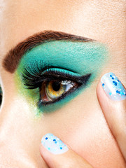 woman eye make-up green vivid fashion