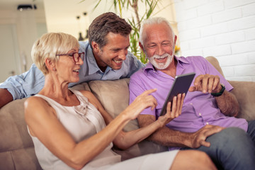 Family using tablet at home