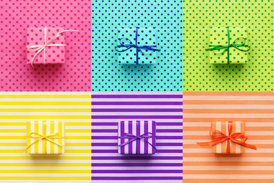 Set of colorful gifts on wrapping paper. Pop art, minimal style background. Cheerful greeting card.