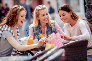 Group of young female friends sitting in cafe