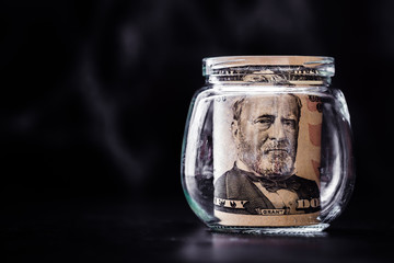 Fifty Dollar Banknotes Rolled Up in Glass Bottle