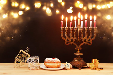 image of jewish holiday Hanukkah background with menorah (traditional candelabra) and burning candles.