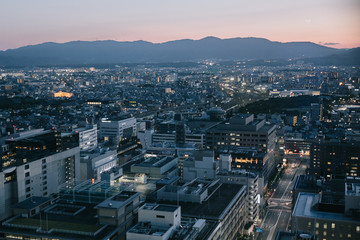 cityscape of Kyoto at night in film vintage style