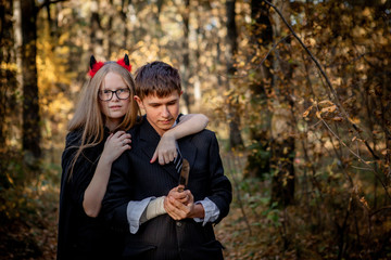Teenagers in Halloween costumes in the woods Wall mural