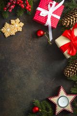 Christmas decorations on dark stone background.