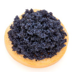 Canapes with black sturgeon caviar on the isolated white background.