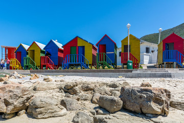 Fotobehang Zuid Afrika Colourful change rooms on the beach