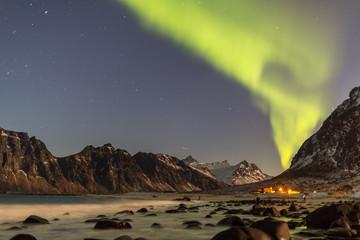 Northern lights in the clear night sky above Uttakleiv beach, Lofoten islands