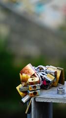 Rome, Italy - September 14, 2018: padlocks left by lovers as a token of love on a bridge over the Tiber