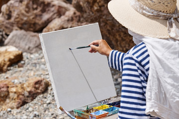 The artist with an easel and colorful paints.