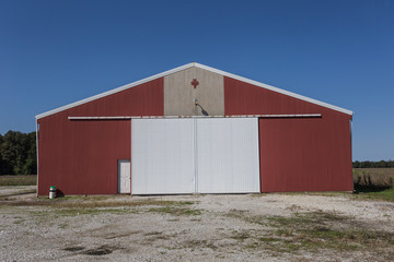 Large red barn with white doors
