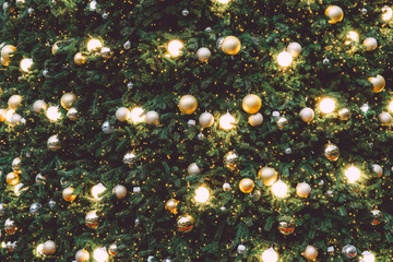 Wall Mural - Vintage Christmas tree with gold ball ornament and sparkle light. Christmas and New Year holiday background. vintage color tone.