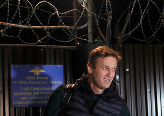 Russian opposition leader Navalny walks out following his release in Moscow