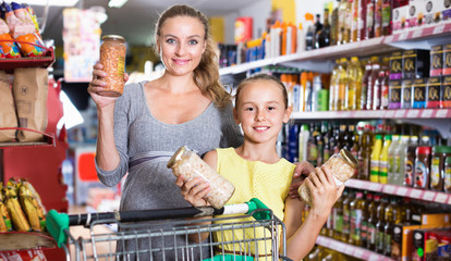 Mother with teenage girl demonstrating their choise in food